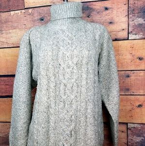 Oversized cable knit turtleneck sweater